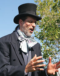 Will George, sporting a rakish top hat, portrays archaeologist, frank Hamilton Cushing. PHOTOS BY PAT NEWMAN