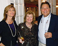 Commissioner Donna Fiala (center) takes a few moments to chat with Darcie and Peter Guerin.