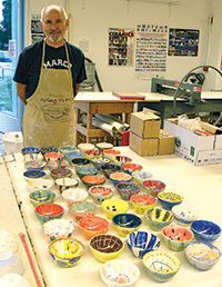 Volunteer and pottery expert Barney Halaschak looks over the finished products. PHOTOS COURTESY OF MARCO ISLAND AREA CHAMBER OF COMMERCE