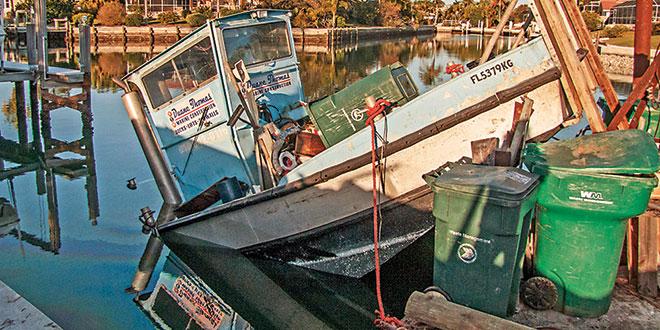 Diesel fuel spills from sunken tug on Hernando canal.