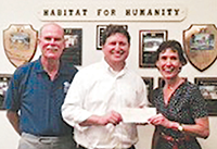 Pastor Mark Williams, presenting a check of $100,000 to Reverend Lisa Lefkow, of Habitat of Collier County. Pictured left to right, Curt Gillespie, Chairman of UCMI Habitat Campaign, Reverend Lisa Lefkow, and Reverend Dr. Mark Williams, Senior minster of United Church.