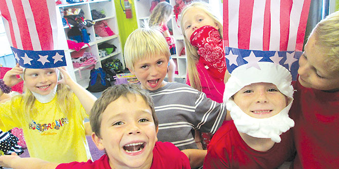 Y Summer Camp- The patriotic spirit was on display with these youngsters at Camp Mackle last year, prior to the Fourth of July. SUBMITTED PHOTOS