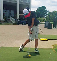 Early extension - a common swing flaw with junior golfers.