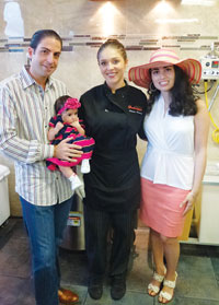 Owners Steven and Gabriella and daughter Chiara pose with confectionery chef Celeste Harrington.