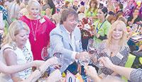 Fun at the Wine Fest (from left): Nancy Plourde, Donna Solimene, Doug Plourdeand Lenka Tichy.