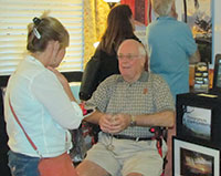 R. Clark Lindberg talking to a guest.