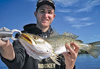 PHOTOS BY CAPT. PETE RAPPS. Billy shows off his catch- a sea trout.