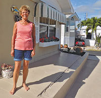 Peggy Ritschard at  rear of home, Drop Anchor to the right. PHOTO BY BARRY GWINN