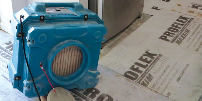 This is one of the 'miraculous' air scrubbers, said to remove dangerous and toxic mold and other air-borne particulates. Running them 24/7 as recommended guaranteed to render you deaf. PHOTO BY CAROL GLASSMAN