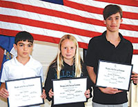 Middle school students Ryan Palumbo, Hailey Cartwright and Zachary DeSerranno proudly display the DAR certificates received for their contest-winning essays. PHOTOS BY CHRIS CURLE