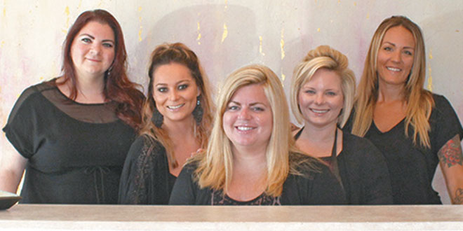 Julie Stoller (center) with her staff. From left: Mary, Kristine, Julie, Sally and Kim. Photos by Samantha Husted