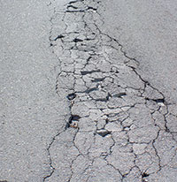 Disintegration or raveling occurs at the site of unattended cracks, or more commonly at the edges of the road. Goodland Roadhas plenty of both. (1/26/16)