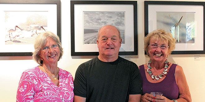 Photo contest judges (from left) Donna Kay, Barry Howe and Andrea Cooper in front of the winning photos