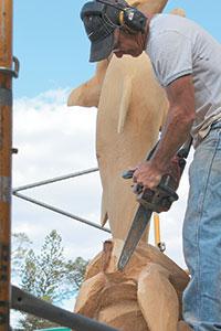 Von Schroth used a raised platform to sculpt the massive piece of wood.