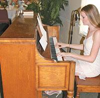 Scholarship recipient Ashley Johnson sangand played the piano.