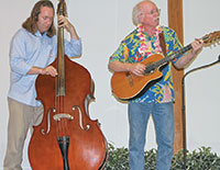 Martin Houghtaling and his father JRobert Houghtaling performed an original song for the group.