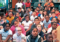 The Manatee Elementary School media center was jammed with kids waiting to receive their free books.