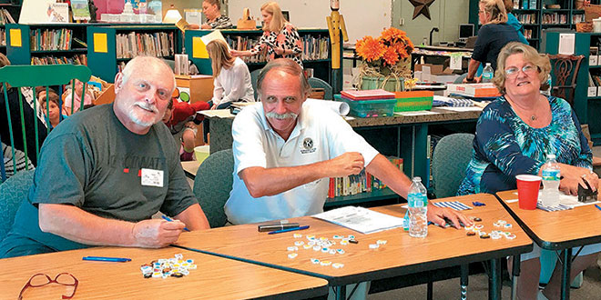 Photos by Janice BaptisteFrom left: Martin Gillieson, Ray McChesney and Gayle Thawley have a little fun before giving away over 600 books to elementary school students.