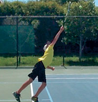 High school team player and part-time, summer resident Robert Brus works on his serve.