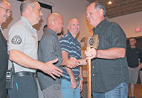Among other items, Chris receives an axe - tradition among firefighters. Photos by Samantha Husted