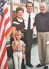 Visiting the fire station: (from left) Chris' son Joseph, mother Maxine (Chris) and father Gerald E. Byrne Jr., M.D.
