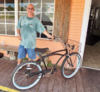 Photo by Barry GwinnSteve Gober with his father's restored Huffy Bicycle. Obviously delighted, Steve didn't have to be coaxed into a smile for this one.