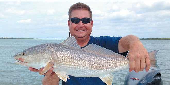 Capt. John from Captain Rapps Charters with a nice slot size redfish. Photo by Capt. Pete Rapps