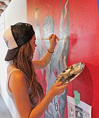 MIA junior Stephanie Simon painting the bicep of late boxer Arturo Gatti. Photos by Samantha Husted