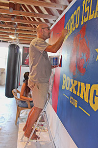 Robert fills in the lettering while Stephanie works on the image of Arturo Gatti.