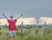 Brandon Black celebrates capturing a tornado on film near Sulphur, Oklahoma.