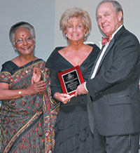 Debra Shanahan (center) is presented with the DistrictGovernor's Award.
