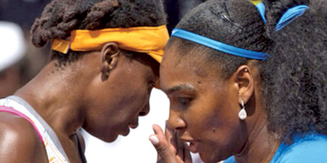 Venus and Serena discussing strategy in between points. Submitted Photos