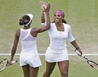 Venus and Serena staying positive after winning a point.