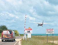 Traffic on the main road stops when planes take off from the Placencia Airport.
