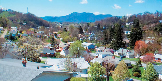 The Canton Chamber of Commerce chose this as one of the views used to attract businesses and new residents to Canton. Bill Gwinn's first Canton house is the white bungalowprominently featured at lower left.