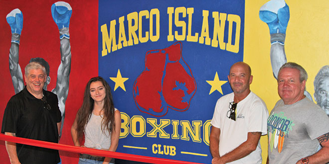 From left: Rich Stoltenborg, Stephanie Simon, Robert Eder and Jimmy Downey stand in front of the completed mural at the Marco Island Boxing Club.