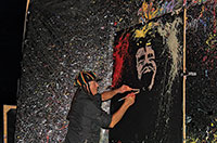John Gowdy creates a portrait of reggae musician Bob Marley during his Flying Colors performance painting show