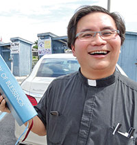 Father Nguyen blessed the new police vessel.