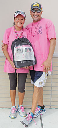 Photo by Samantha HustedAna and Cary. On Ana's backpack are images of her mother and her sister. Ana's mother died from breast cancer, and her sister is currently in remission..
