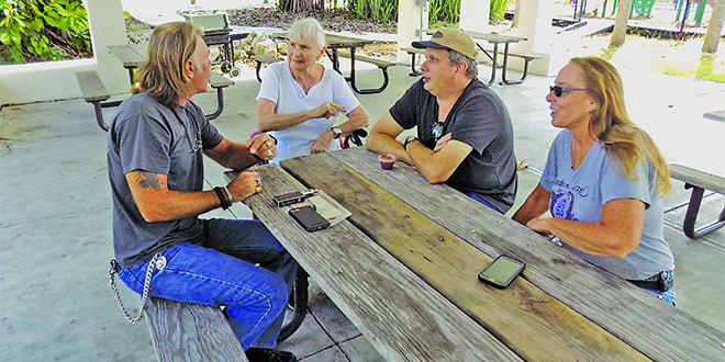 Photos by Barry Gwinn:  From left: Mark Kennedy, his mother, Mary Kean, Bill Mueller, and Carol Hughes. Curious as to why Governor Scott kept coming to the Kirk Fish Market in Goodland, the four friends came over from Naples to find out.