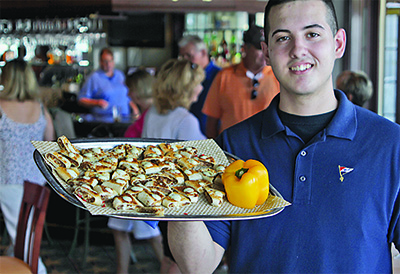 Robert Aylwin, son of chef Bob Aylwin, offers lamb quesadillas.