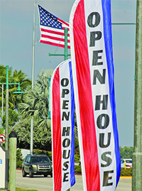 Photos by Quentin Roux:Drivers heading off the island Saturdaywould have seen these promotional signsfor the MIYC open house.