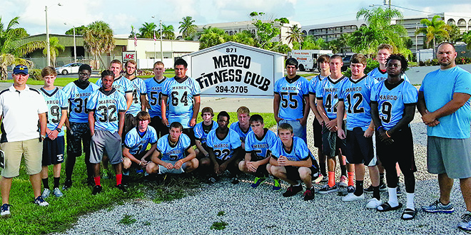 Submitted Photos:Coach Greg Fowler with his 2014 MIA football team, in what became a successful, long-standing collaboration between MIA and the MarcoFitness Club.