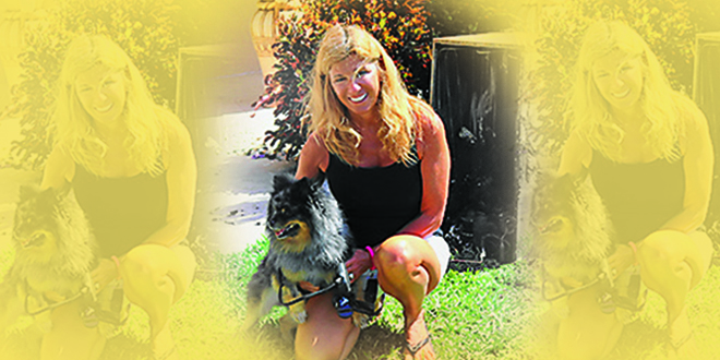 Photo by Steve Stefanides | CeCe Krokenberger of Rochester, N.Y. owes her life to her small dog Shultz, a Blue Merle Pomeranian.