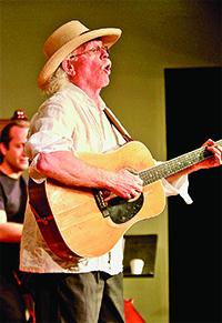 JRobert on his 1967 Martin guitar, entertains a receptive crowd. Photos by Scott Shook