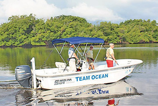 A Team Ocean boat heads to a high use area in the estuary. Team Ocean, an organization of local boaters, supports RBR by keeping tabs on what is going on in the high use areas and reporting their findings to RBR.