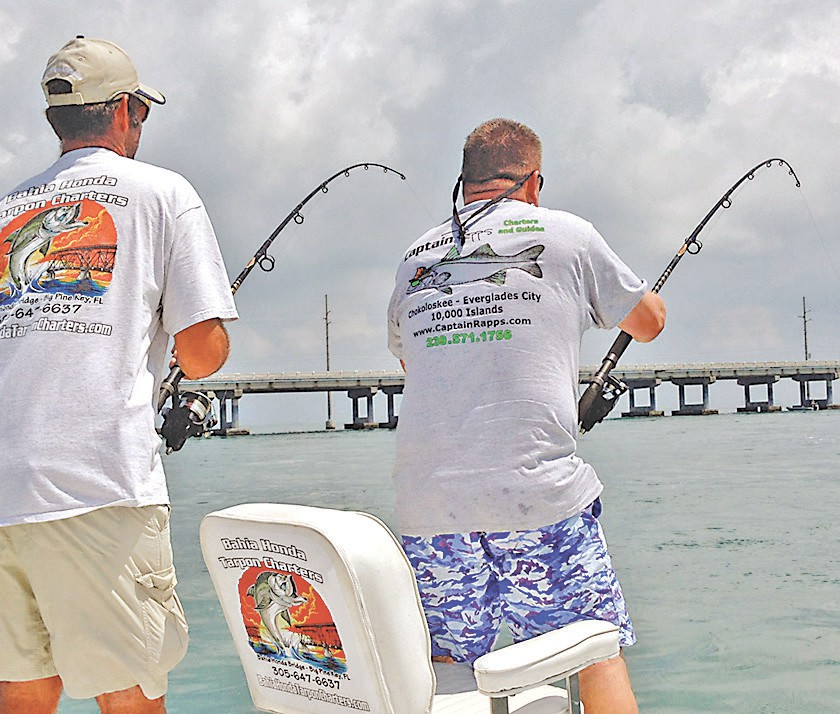 Kevin and John work hard to reel in fish on a Captain Rapps fishing charter. Photos by Capt. Pete Rapps