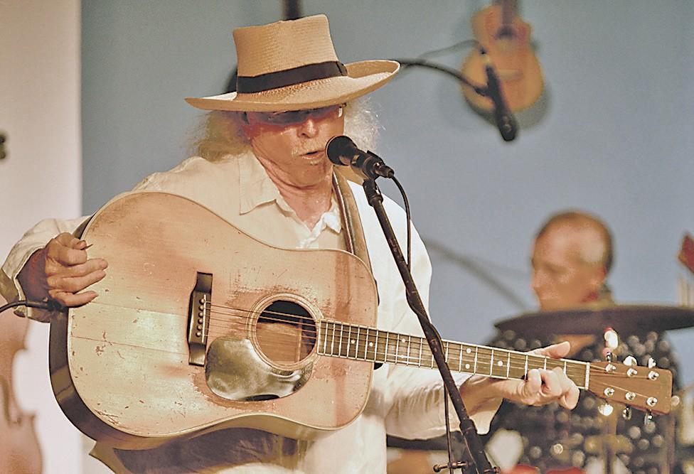Florida Songwriter Showcase maestro JRobert with his prized vintage Martin guitar.